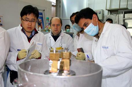 IAEA team checks the enrichment process inside the uranium enrichment plant Natanz...