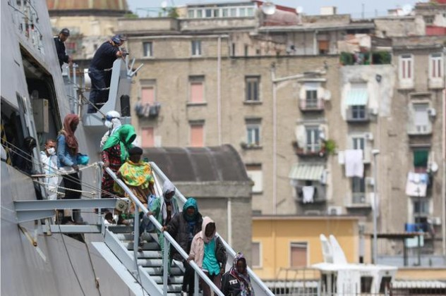 Migrants disembarked in Naples' harbor