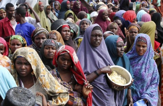 Internally displaced Somali women wait for food at a camp in the capital Mogadishu