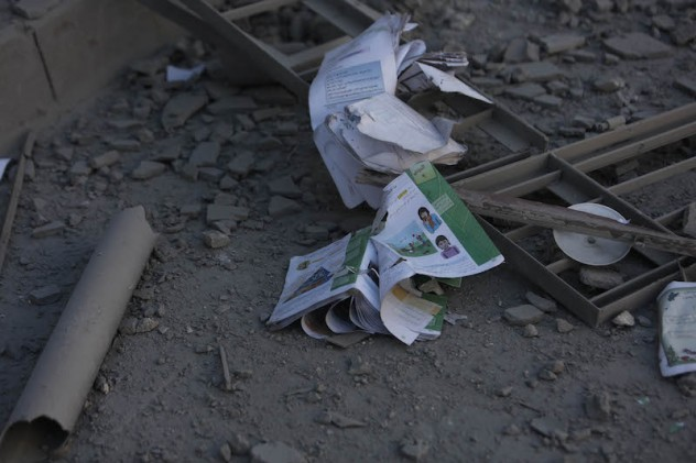Books and papers lie on the ground in a destroyed school, Eastern Ghouta