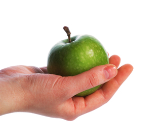 The thrown green tasty-looking apple from hand