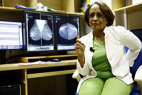 TO GO WITH AFP FOCUS STORY BY TOM LITTLE Sudanese radiologist Dr Hania Fadl gives an interview at the Khartoum Breast Care Centre (KBCC) on October 15, 2015. Ignoring financial advisers' warnings to abandon the project, Fadl pressed on, buying a digital mammogram machine for screening and two anaesthetic machines, and eventually opening the KBCC in October 2010. AFP PHOTO/ ASHRAF SHAZLY        (Photo credit should read ASHRAF SHAZLY/AFP/Getty Images)