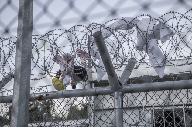 A toy stuck in the razor wire which hugs Moria detention centre in Lesvos, Greece.