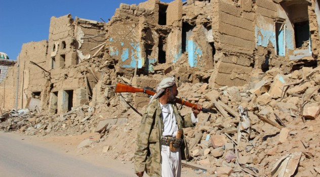 A Houthi armed man walks past destroyed houses in the old quarter of the northwestern city of Saada, Yemen January 11, 2017. REUTERS/Naif Rahma - RTX2YH75