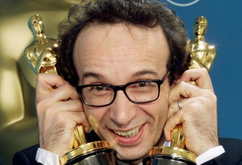 "OSC110D:ENTERTAINMENT-OSCARS:LOS ANGELES,21MAR99 - Italian actor and director Roberto Benigni poses with two Oscar statues his film ""Life is Beautiful"" won at the 71st Annual Academy Awards, March 21 at the Dorothy Chandler Pavilion in Los Angeles. Benigni was honored with awards for Best Actor and Best Foreign Film. ssm/Photo by Blake Sell REUTERS"