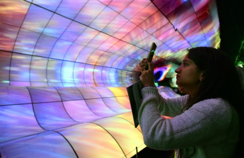 LAS VEGAS, NEVADA - JANUARY 08: An attendee photographs an exhibit of LG OLED TV screens at the LG booth at CES 2019 at the Las Vegas Convention Center on January 8, 2019 in Las Vegas, Nevada. CES, the world's largest annual consumer technology trade show, runs through January 11 and features about 4,500 exhibitors showing off their latest products and services to more than 180,000 attendees. David Becker/Getty Images/AFP == FOR NEWSPAPERS, INTERNET, TELCOS & TELEVISION USE ONLY ==