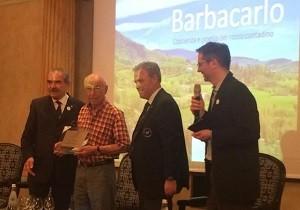 Da sinistra: Fiorenzo Detti presidente Ais Lombardia, Lino Maga, Antonello Maietta, presidente Ais Samuel Cogliati alla festa per i 50 anni di fondazione dell'Ais
