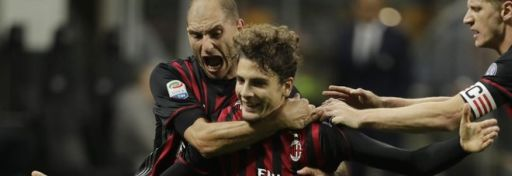 AC Milan's Manuel Locatelli, center, celebrates with teammate AC Milan's Gabriel Paletta, left, and AC Milan's Ignazio Abate, after scoring during a Serie A soccer match between AC Milan and Juventus, at the San Siro stadium in Milan, Italy, Saturday, Oct. 22, 2016. (AP Photo/Luca Bruno)