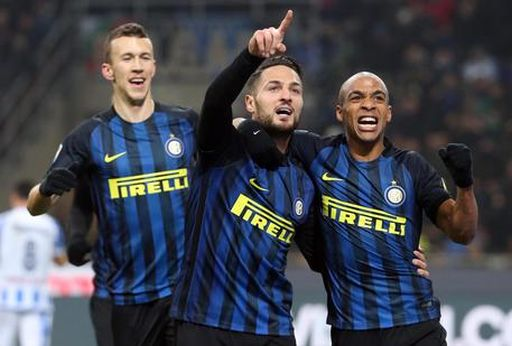 Inter's Danilo D'Ambrosio (C) jubilates with his teammates Ivan Perisic and Joao Mario (R) after scoring the goal during the Italian Serie A soccer match Inter FC vs Pescara Calcio at Giuseppe Meazza stadium in Milan, Italy, 28 January 2016. ANSA/MATTEO BAZZI