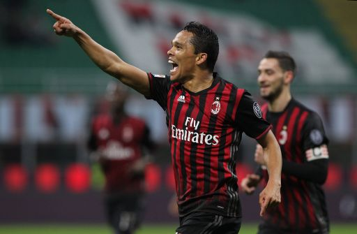 MILAN, ITALY - MARCH 04: Carlos Bacca of AC Milan celebrates after scoring the opening goal during the Serie A match between AC Milan and AC ChievoVerona at Stadio Giuseppe Meazza on March 4, 2017 in Milan, Italy. (Photo by Marco Luzzani/Getty Images)