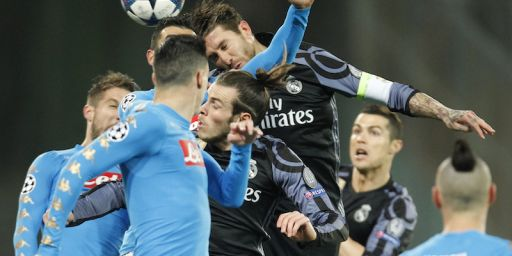Real Madrid's defender Sergio Ramos (top) heads the ball during the UEFA Champions League football match SSC Napoli vs Real Madrid on March 7, 2017 at the San Paolo stadium in Naples. / AFP PHOTO / Carlo Hermann (Photo credit should read CARLO HERMANN/AFP/Getty Images)
