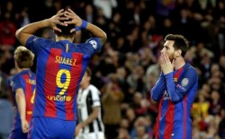 FC Barcelona's strikers Lionel Messi (R) and Luis Suarez react after missing a goal opportunity during the UEFA Champions League quarter-final second leg match between FC Barcelona and Juventus at the Camp Nou stadium, in Barcelona, Catalonia, Spain, 19 April 2017. EFE/Alberto Estevez