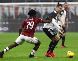 MILAN, ITALY - FEBRUARY 13: Cristiano Ronaldo (E) of Juventus competes for the ball with Franck Kessie (L) of AC Milan during the Coppa Italia Semi Final match between AC Milan and Juventus at Stadio Giuseppe Meazza on February 13, 2020 in Milan, Italy. (Photo by Marco Luzzani/Getty Images)