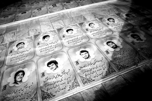 Pictures of martyrs from the Iran-Iraq war in Qom.
