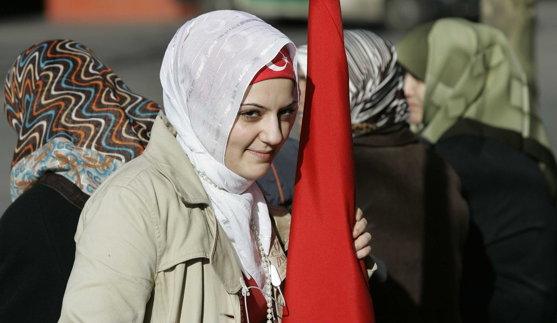 Women from the Turkish community wait for Turkish Prime Minister Tayyip Erdogan to arrive at the Koelnarena in Cologne