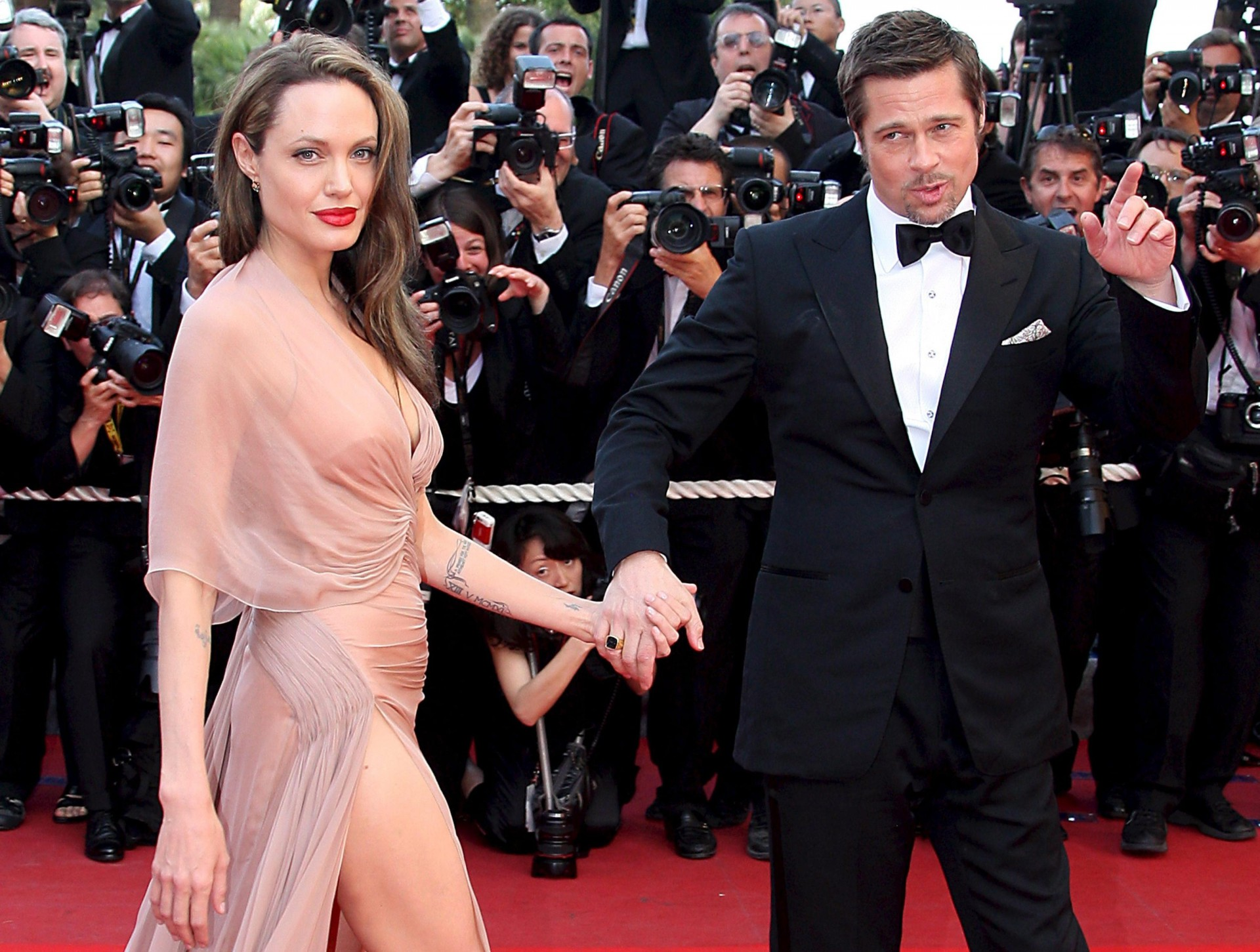 epa05549365 (FILE) A file picture dated 20 May 2009 shows US actors Brad Pitt (R) and Angelina Jolie (L) arriving for the gala screening of the film 'Inglourious Basterds' at the 62nd edition of the Cannes film festival in Cannes, France. According to media reports from 20 September 2016, Angelina Jolie filed for divorce from her husband Brad Pitt, as her lawyer confirmed. EPA/CHRISTOPHE KARABA