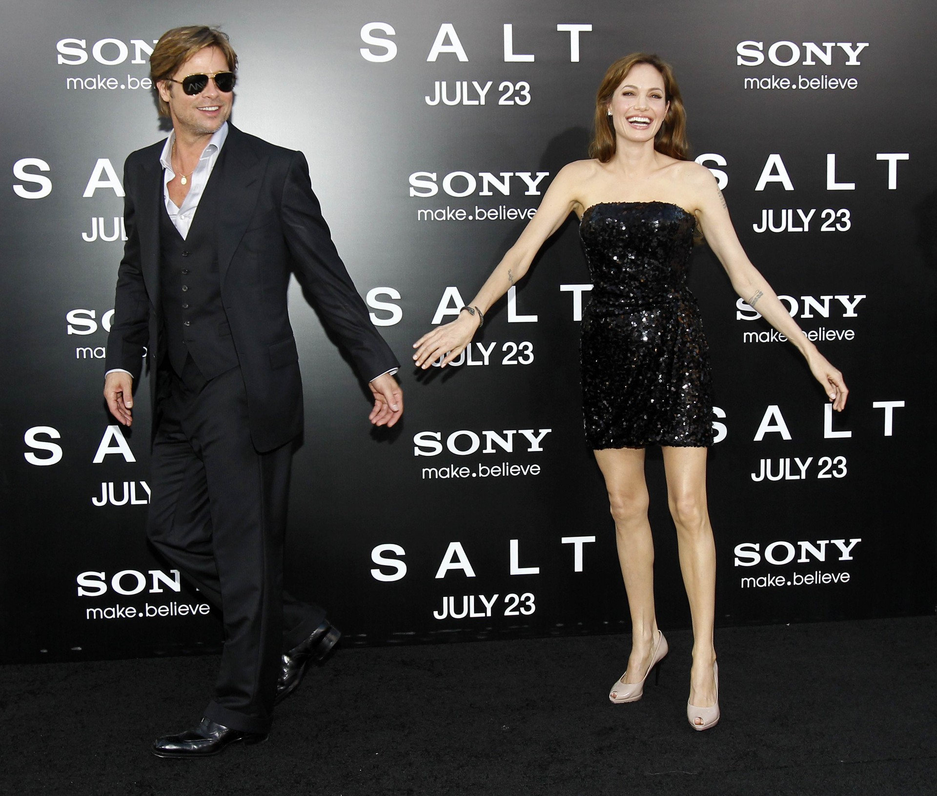 "Cast member Angelina Jolie and actor Brad Pitt smile at the premiere of the movie ""Salt"" at the Grauman's Chinese theatre in Hollywood, California July 19, 2010. The movie opens in the U.S. on July 23. REUTERS/Mario Anzuoni (UNITED STATES - Tags: ENTERTAINMENT)"