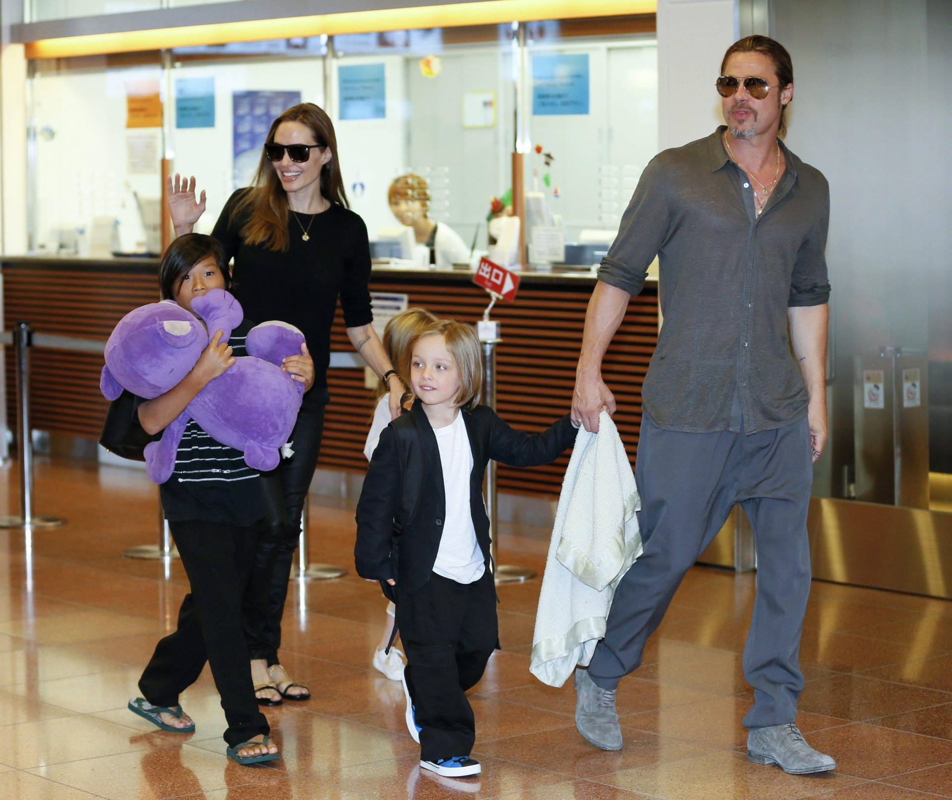 epa05549359 (FILE) A file picture dated 28 July 2013 shows US actors Angelina Jolie (2-L) and Brad Pitt (R) arriving with their children Pax Thien (L), Shiloh (hidden) and Knox Jolie-Pitt at Tokyo International Airport at Haneda, in Tokyo, Japan. According to media reports on 20 September 2016, Angelina Jolie has filed for divorce from her husband Brad Pitt, her lawyer confirmed. EPA/KIMIMASA MAYAMA