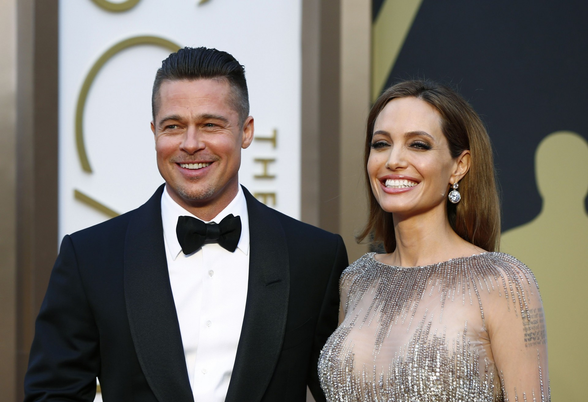"Actor Brad Pitt and actress Angelina Jolie arrive at the 86th Academy Awards in Hollywood, California in this March 2, 2014 file photo. Brad Pitt and Angelina Jolie, the glamorous Hollywood couple dubbed ""Brangelina"" in tabloid headlines, were married in France, according to media reports on August 28, 2014. REUTERS/Lucas Jackson/Files (UNITED STATES - Tags: ENTERTAINMENT)"