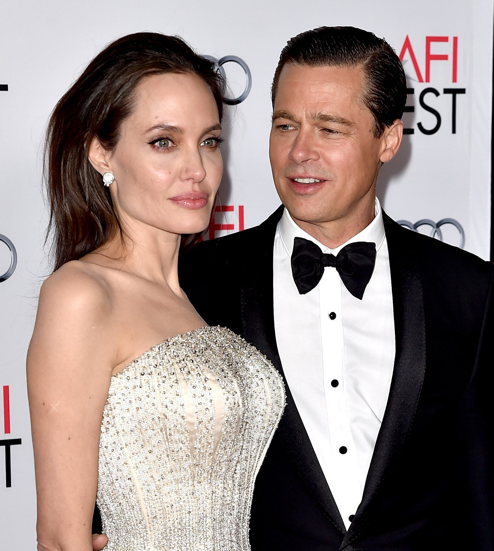 "LOS ANGELES, CA - NOVEMBER 05: Actress/director Angelina Jolie Pitt (L) and husband actor Brad Pitt arrive at the AFI FEST 2015 presented by Audi opening night gala premiere of Universal Pictures' ""By The Sea"" at the Chinese Theatre on November 5, 2015 in Los Angeles, California. Kevin Winter/Getty Images/AFP == FOR NEWSPAPERS, INTERNET, TELCOS & TELEVISION USE ONLY =="