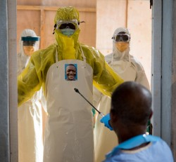 Health care workers in the ELWA II ETU (Ebola treatment unit), Monrovia, Liberia on Friday, March 6, 2015. Occidental College professor Mary Beth Heffernan's PPE Portrait Project involves creating wearable portraits of the health care workers who must wear PPE (personal protective equipment) when working with patients. (Photo by Marc Campos, Occidental College Photographer)