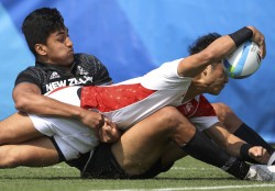 2016 Rio Olympics - Rugby - Preliminary - Men's Pool C New Zealand v Japan - Deodoro Stadium - Rio de Janeiro, Brazil - 09/08/2016. Kazushi Hano (JPN) of Japan stretches to score a try as he is tackled by Rieko Ioane (NZL) of New Zealand. REUTERS/Phil Noble (BRAZIL - Tags: SPORT OLYMPICS SPORT RUGBY TPX IMAGES OF THE DAY) FOR EDITORIAL USE ONLY. NOT FOR SALE FOR MARKETING OR ADVERTISING CAMPAIGNS.