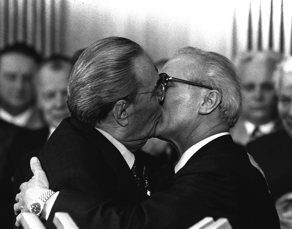 "BER6 Berlin, East Germany, Oct. 4, 1979 - Soviet President Leonid Brezhnev and East German leader Erich Honecker change kisses after Brezhnev was honored with the title ""Hero of the German Democratic Republik"" and the ""Karl Marx Medal"". Brezhnev participates in the celebrations marking the 30th anniversary of the East German State`s foundation. (AP Photo/Helmuth Lohmann/stf)"