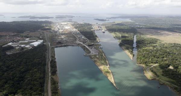 This aerial view shows the new Panama Canal expansion project, left, including the Gatun Locks on the right, during a media tour organized by contractor Salini Impregilo, in Gatun, Panama, Monday, March 23, 2015. The Panama Canal expansion is undergoing the biggest expansion since it opened in 1914, which will allow larger Post-Panamax ships to cross the canal. (ANSA/AP Photo/Arnulfo Franco)