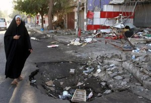 An Iraqi woman walks at the scene of a car bomb attack in Karada district, central Baghdad, Iraq, 13 August 2014. According to media reports, at least 12 people were killed in different car bomb attacks in Baghdad on 12 August. Iraq has been wracked by violence over the past year, much of it blamed on the Sunni jihadist group, Islamic State, and aimed at security forces and Shiite civilians. ANSA /ALI ABBAS