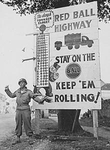 """Cartello stradale: """"Autostrada Palla Rossa. State sulla palla. Fateli muovere"""""""