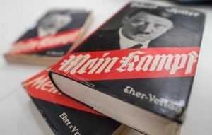 "FILE - In this Dec. 11, 2015, file photo, different editions of Adolf Hitler's ""Mein Kampf"" are on display at the Institute for Contemporary History in Munich. For 70 years since the Nazi defeat in World War II, copyright law has been used to prohibit the publication of Mein Kampf, the notorious anti-Semitic tome in which Hitler set out his ideology, in Germany. That will change in January 2016, when a new edition with critical commentary, the product of several years' work by a publicly funded institute, hits the shelves. While historians say it could help fill a gap in Germans' knowledge of the era, Jewish groups are wary. (Matthias Balk/dpa via AP)"