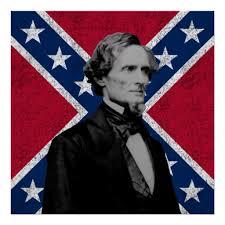 Il presidente confederato Jefferson Davis con sullo sfondo la bandiera confederata (da historycollection)