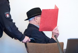epaselect epa07926920 Defendant Bruno D. arrives in the court room of the Higher Regional Court of Hamburg, Germany, 17 October 2019. The 93-year-old Bruno D. is accused of having served as a guardsman at the concentration camp Stutthof near Danzig in 1944 and 1945, abetting murder of more than 5,000 inmates of the camp. EPA/Daniel Bockwoldt / POOL