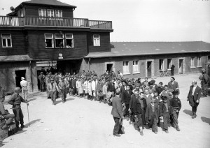 ** FILE -- TO GO WITH BUCHENWALD ANNIVERSARY STORY BY TONY CZUCZKA ** Inmates of the German concentration camp Buchenwald near Weimar, Germany, march to receive treatment at an American hospital after the camp is liberated by Gen. Patton's 3rd U.S. Army troops, in April 1945. (AP Photo/Byron H. Rollins)